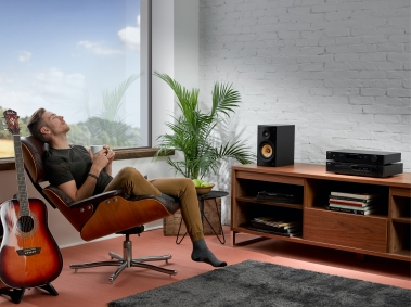 C 338 C568 White Brick Living Room with Male Model and Guitar